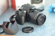 Зеркальная камера Canon EOS 1100D с объективом Kit 18-55mm